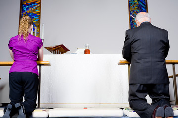 Senior Caucasian Man Woman Kneeling Communion Rail