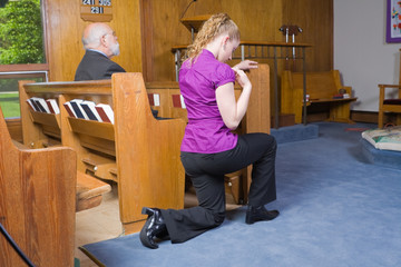Caucasian Woman Kneeling Crossing Herself Church