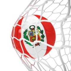 Peruvian soccer ball inside the net