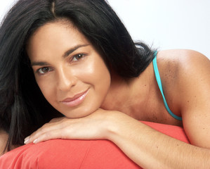 Young latin woman portrait on bed.