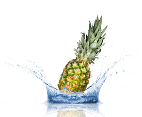 Fresh pine-apple dropped into water