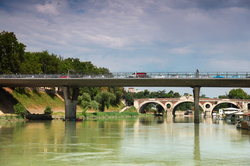 cars go over bridge on Tiber River, away bridge Trastevere