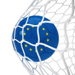 European soccer ball inside the net