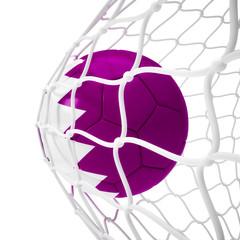 Qatari soccer ball inside the net