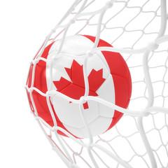 Canadian soccer ball inside the net