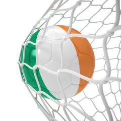 Ivorian soccer ball inside the net