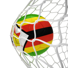 Zimbabwean soccer ball inside the net