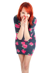 smiling young red hair woman with palms on mouths