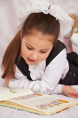 A child reading a book.