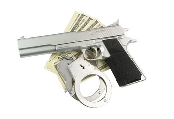Stack of money, gun and handcuffs isolated on white