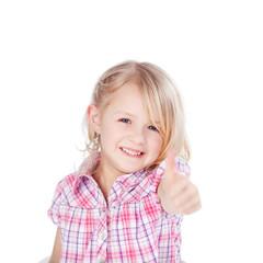 lachendes kind zeigt daumen hoch