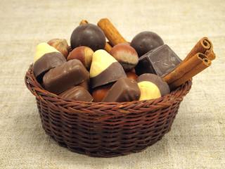 Cinnamon sticks, chocolate candies and hazelnuts