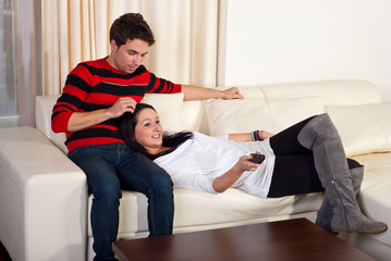 Loving young couple on sofa
