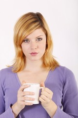 Young woman with a coffee mug
