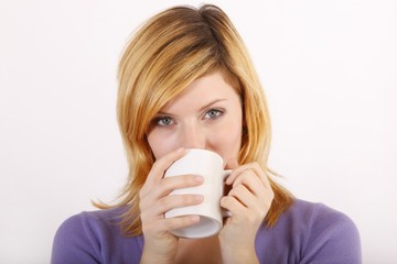 Young woman with a coffee mug