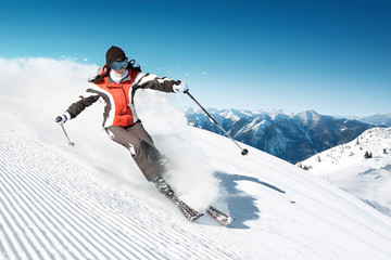Woman skiing in high mountains - modified piste