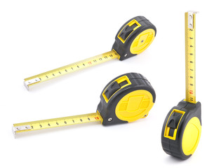 Yellow tape measure with soft shadow