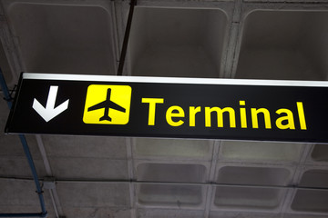 Illuminated Yellow Airport Terminal Sign