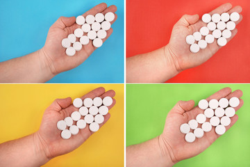 The arrow is combined from white tablets. The arrow lays on a ha