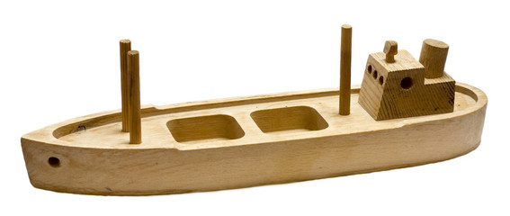 Old wooden toy boat isolated on white background