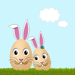 Pair of cute easter bunny, rabit/egg on the green meadow.