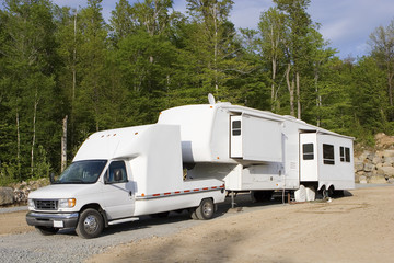 Fifth wheel trailer parked at a campground