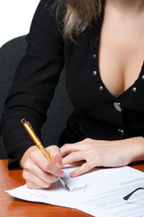The business woman signs the contract. Photo closeup