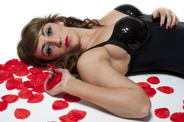 Beautiful young female with rose petals isolated