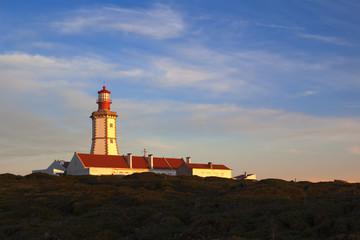 Cape Espichel lighthouse on sunset light