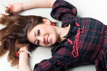 Beautiful teenager girl lying on the floor