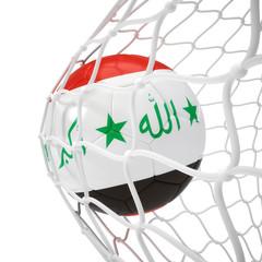 Iraqi soccer ball inside the net