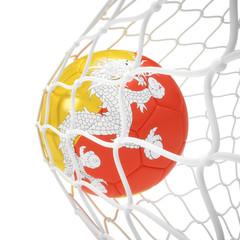 Bhutan soccer ball inside the net