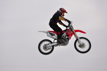 motocross, winter, rider jumps outdoors.