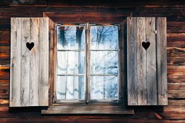 Old window shutters in  wooden wall