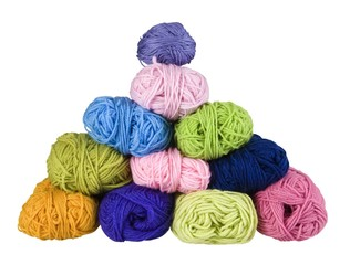 pile of colorful balls of wool on a white background