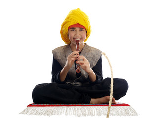 boy playing the flute charming a rope
