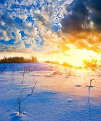 sunset on a snow desert