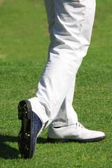 Detail of man playing golf