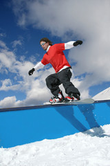 Wall Mural - Snowboarder in snow park