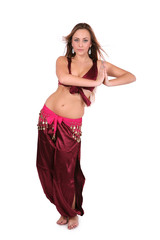 Beautiful belly dancer in red costume