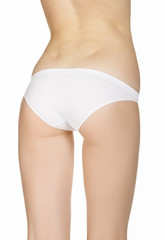 Beautiful slim female body in underwear, isolated on white backg