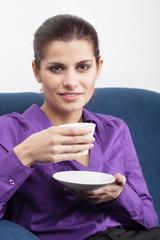 Young businesswoman having coffee break