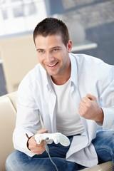 Young man enjoying video game smiling