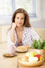 Happy woman having breakfast