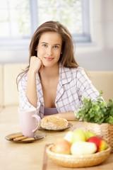 Happy woman having breakfast