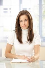 Portrait of elegant woman taking notes