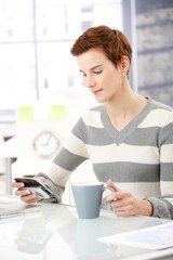 Office worker girl with smartphone