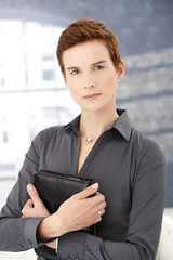Determined businesswoman in office