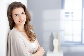 Attractive woman smiling happily at home