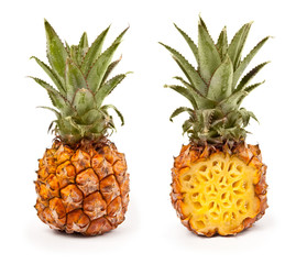 Fresh pineapple closeup isolated on white